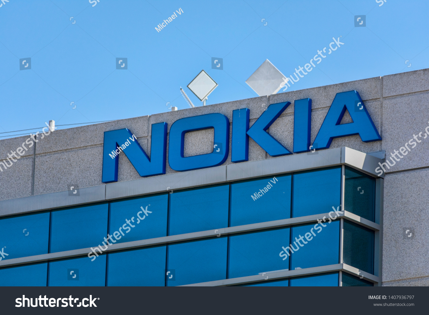 stock-photo-nokia-sign-on-corporate-campus-in-silicon-valley-nokia-is-finnish-multinational-telecommunications-1407936797